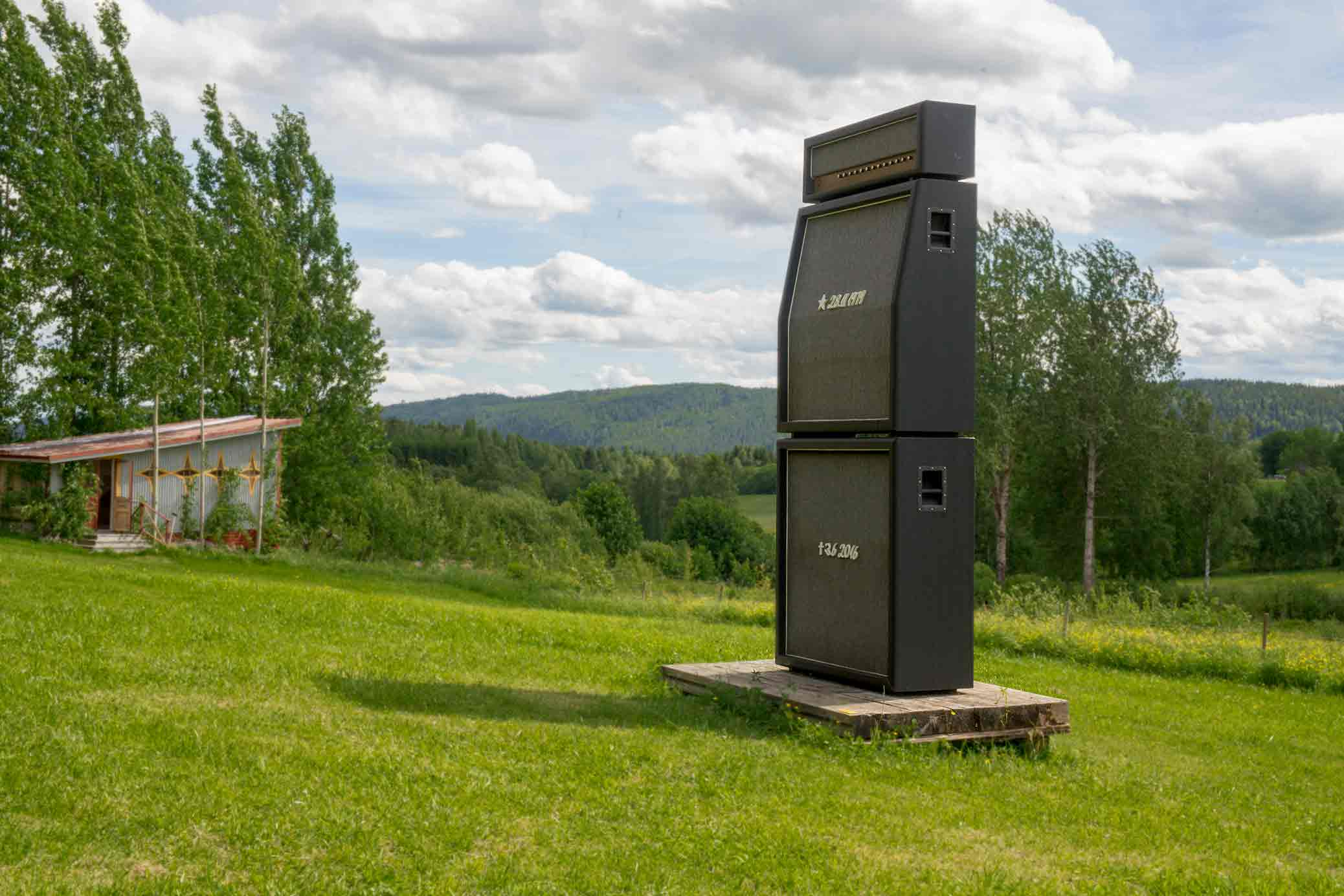 Alma Löv Museum 2017, Balancing The Books, a sound sculpture in the shape of a Marshall stack and a grave stone, out in the field.