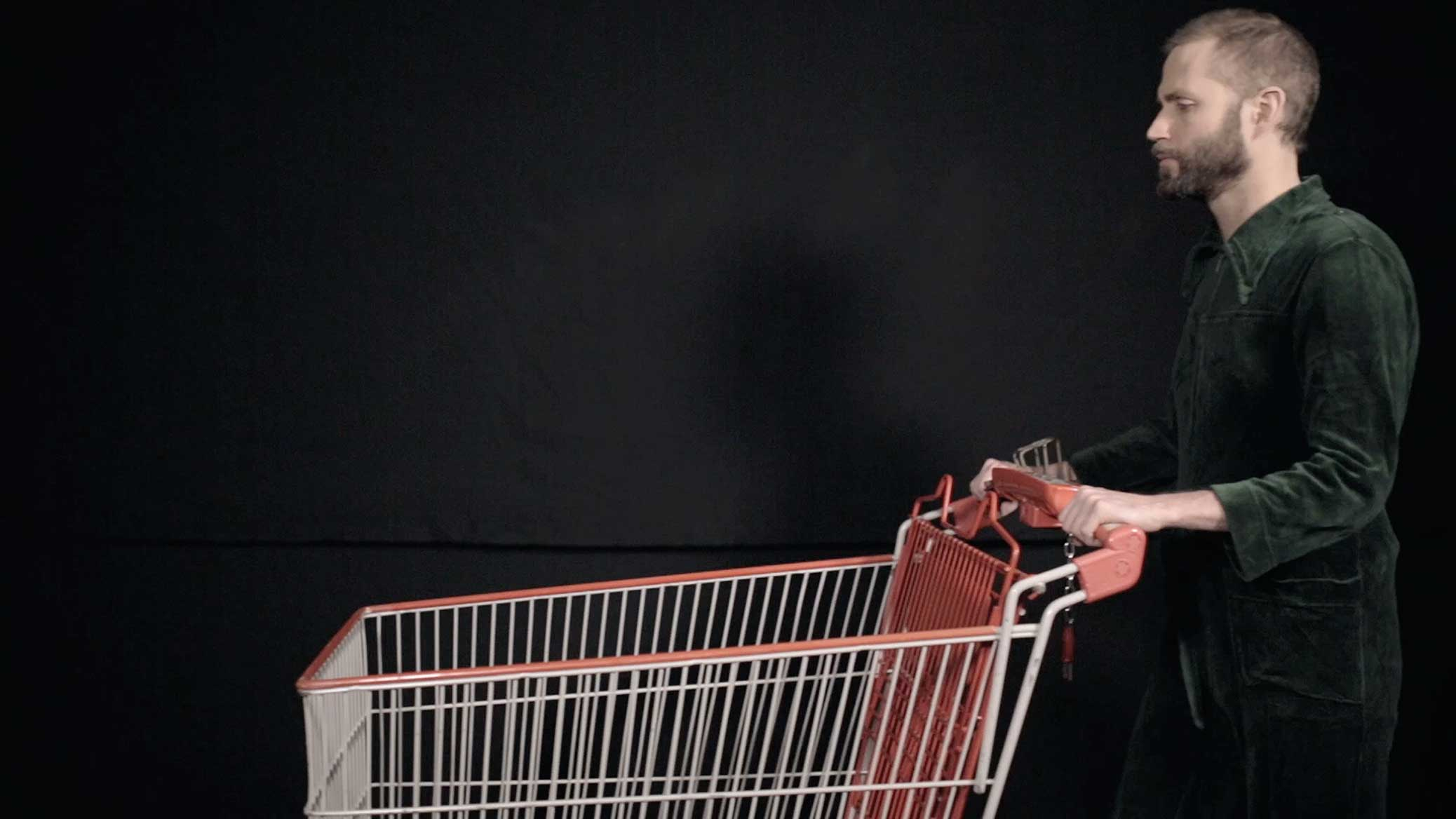 Eight-hour Day, film still, Björn Perborg with shopping cart.