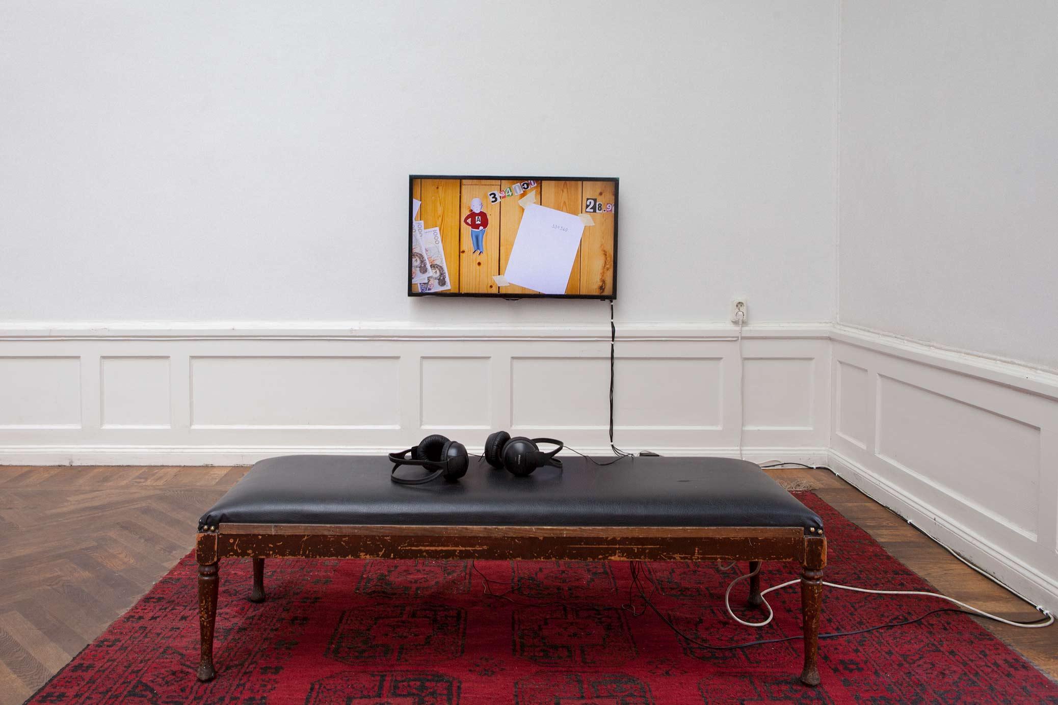 I huvudet på Björn Perborg, utställning på Konstnärshuset. Videokonstnären & pengarna, animation på väggfast monitor.
