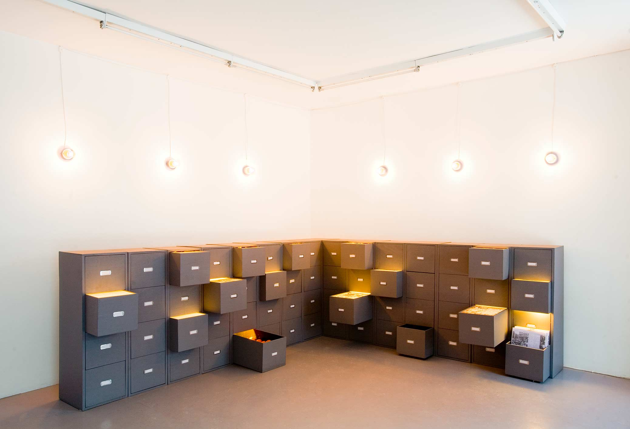 The Collectors, installation with filing cabinets at Galleri Box.