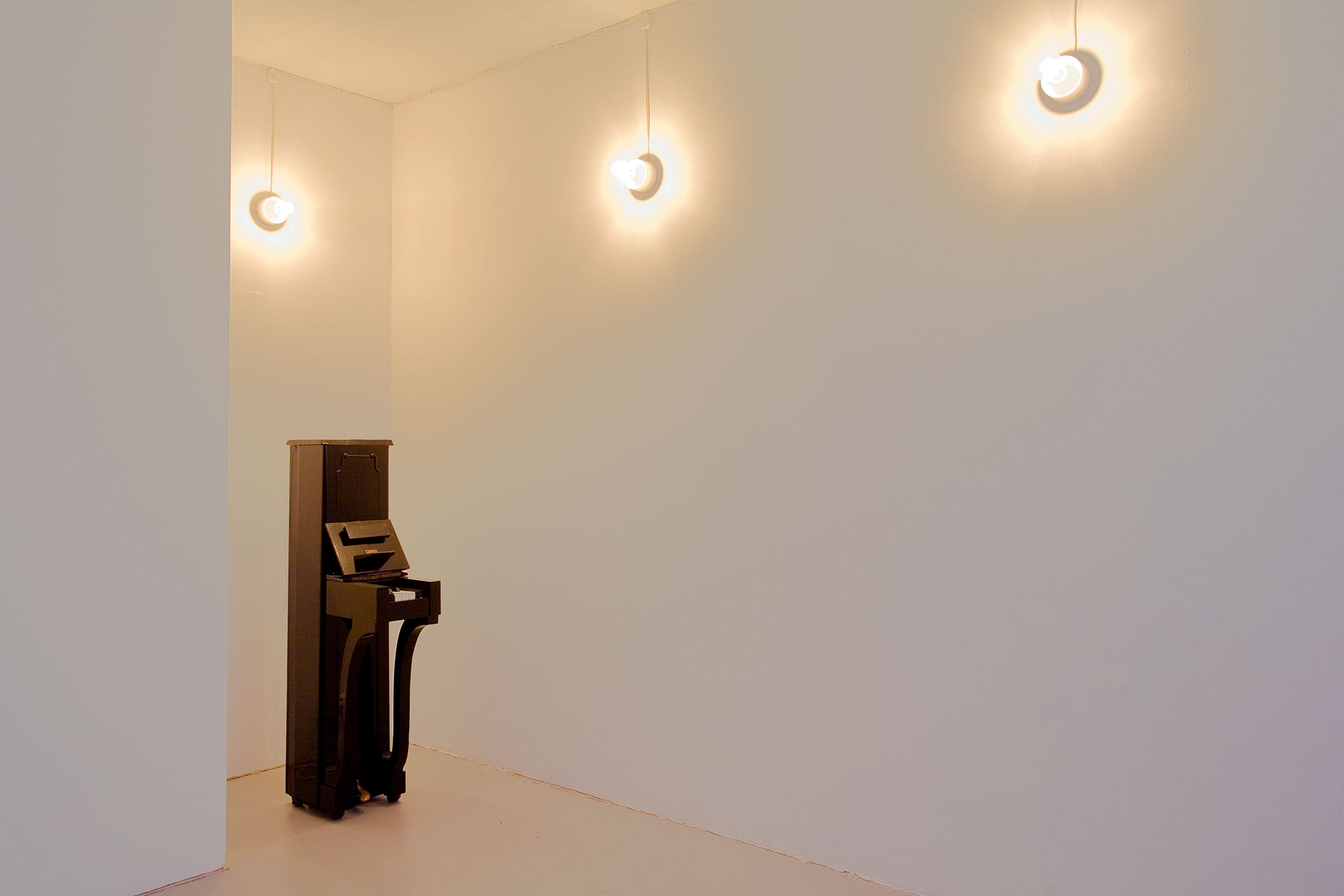 The Collectors, installation with filing cabinets at Galleri Box. Narrow piano sculpture.